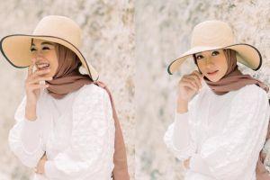 7 Potret terbaru  Poppy Bunga, ibu dua anak yang kian menawan