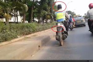 VIDEO: Polisi nakal, berkendara tanpa helm & motornya tanpa plat nomor