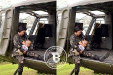 Tentara wanita ini menyusui bayinya di helikopter di sela-sela tugas