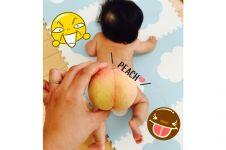 Tren pantat buah peach bayi ini bikin gemes, deh!