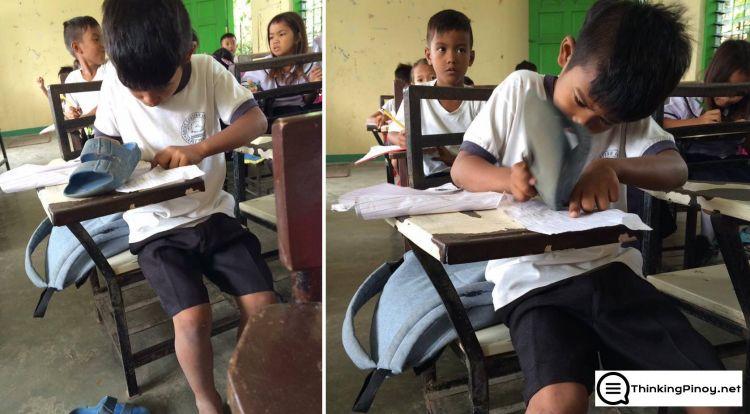 Siswa SD ini hapus tulisan di buku pakai sandal, duh kasihan!