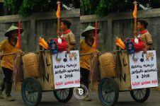 Potret ayah antar anaknya ikut Jambore Pramuka ini bikin salut!