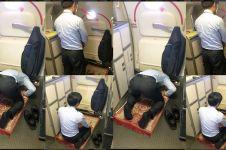 Foto kepala awak kabin salat di pesawat ini dibanjiri pujian netizen