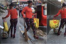 Tukang sapu wanita ini pakai high heels saat bekerja di jalanan