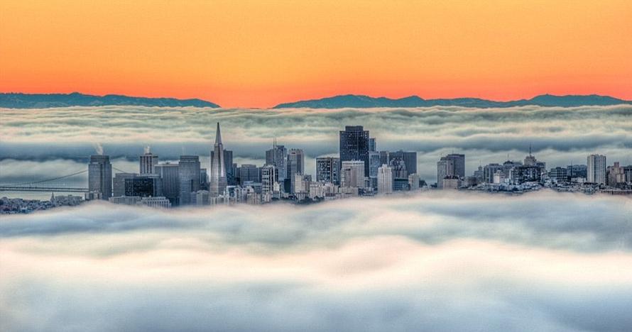 10 Foto kota diselimuti kabut ini bikin serasa berada di kayangan