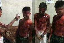 Bikin jera, pelaku vandalisme ini dipaksa semprot cat di tubuh sendiri