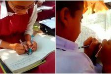 Di sekolah ini siswanya bisa menulis dua tangan dalam waktu bersamaan