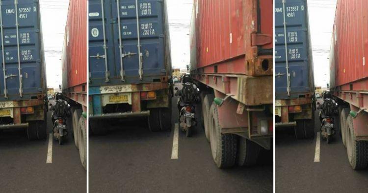 Cara pengendara motor salip truk ini menantang maut, jangan ditiru