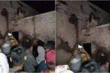 Penampakan sosok berambut panjang di atap gereja, bikin geger netizen