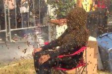 Sejam dikerumuni 100 ribu lebah, pria ini pecahkan rekor baru dunia