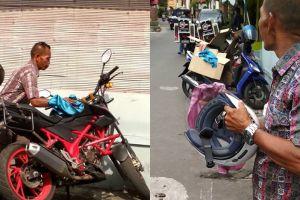 Tak hanya menjaga motor, aksi tukang parkir ini tuai pujian warganet