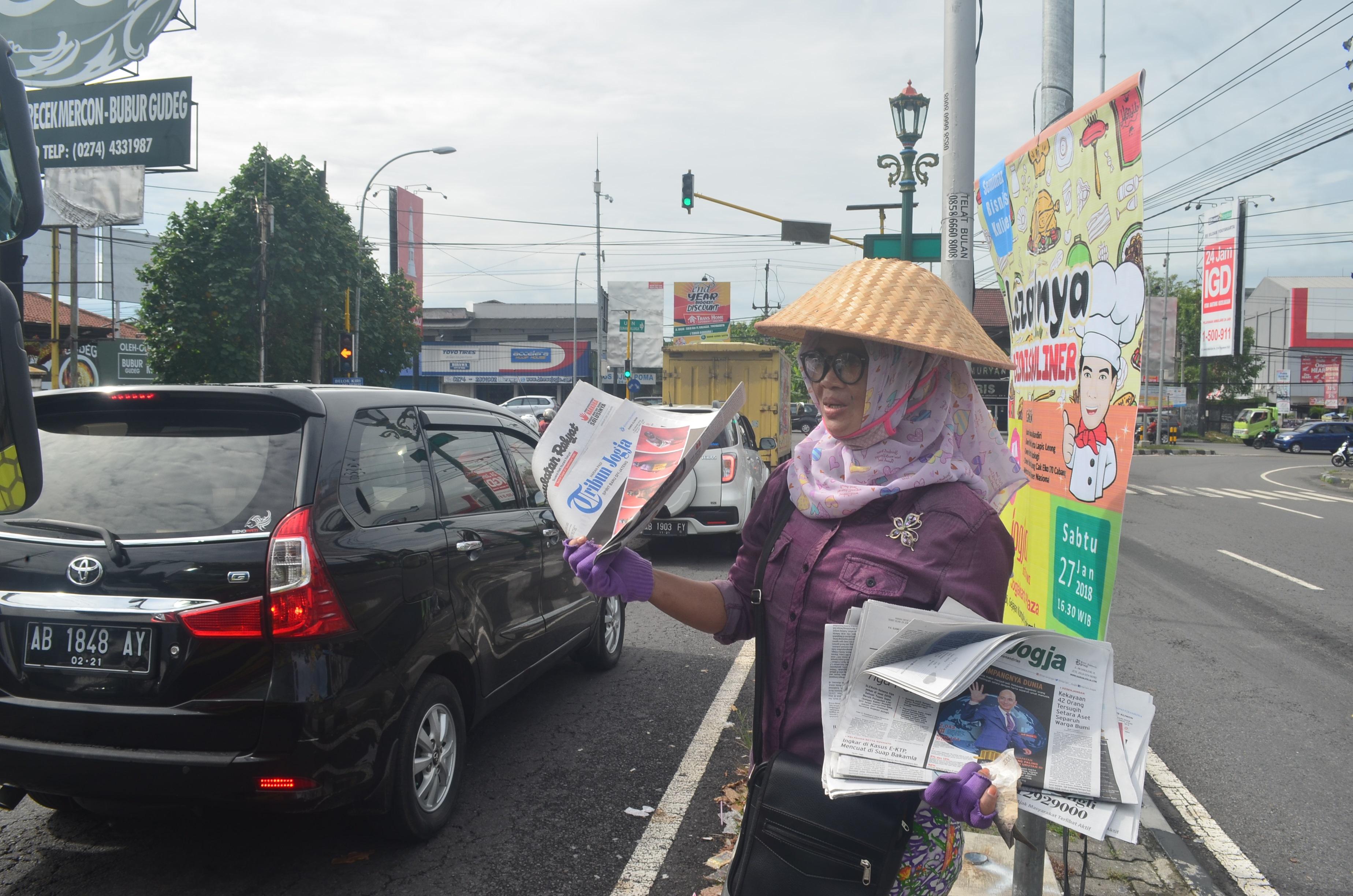 Kisah Hani, pengasong koran tampil modis usai dihina pengguna jalan