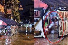 Potret orang makan dengan tenang di tengah banjir ini tuai kontroversi