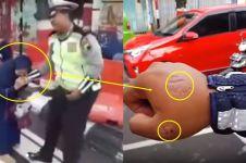 Ini pengakuan polisi yang digigit emak-emak ogah ditilang