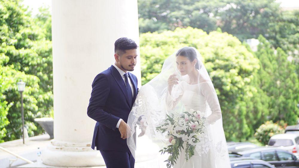 Momen nikahan Petra dan Firrina  © 2018 brilio.net