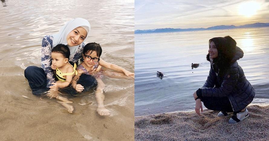 Gaya 7 seleb berhijab main air laut di pantai, pesonanya bikin adem