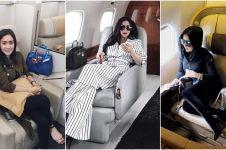 Gaya mewah 10 seleb saat bawa tas ratusan juta di pesawat, glamor abis