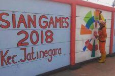 Baru selesai dibuat, mural Asian Games ini sudah dicoret-coret