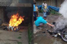 Habis dicuci dan mesin mati, sepeda motor ini tiba-tiba terbakar