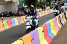 Kembali dicat hitam-putih, ini 11 potret perubahan separator Jakarta