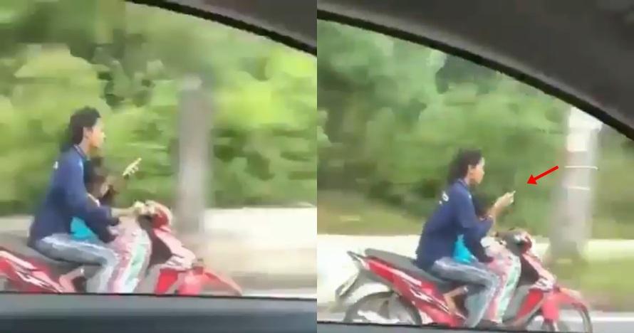 Aksi emak-emak naik motor sambil main HP ini bikin jantung mau copot