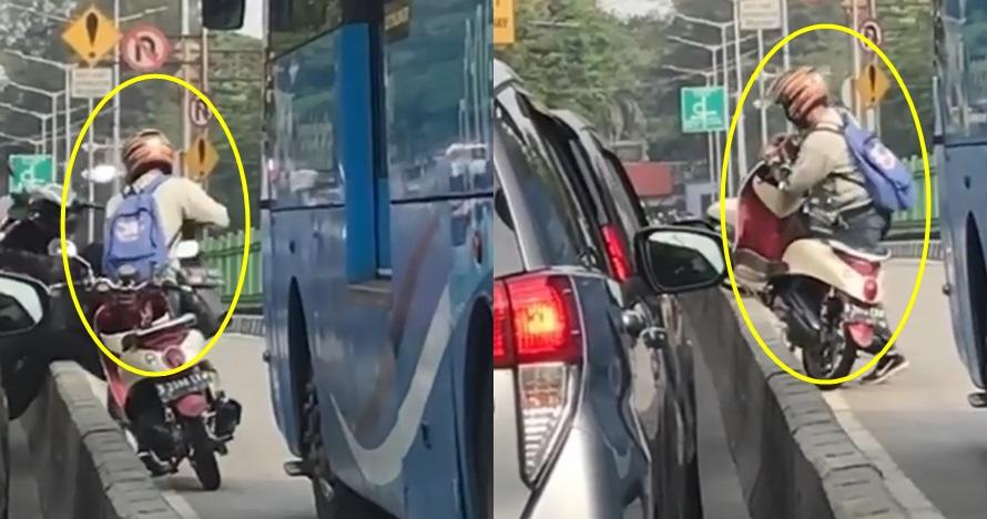 Bantu angkat motor dari separator busway, nasib pria ini apes banget