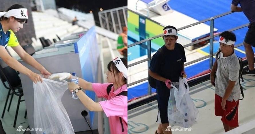 Selain puntung rokok, suporter Jepang juga bersihkan arena renang AG