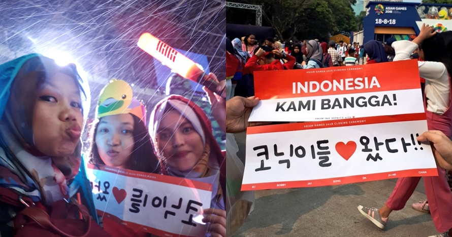 5 Aksi total fans iKon menunggu idolanya di GBK, rela hujan-hujanan