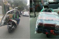 10 Momen perjuangan driver ojol angkut barang kiriman, bikin terenyuh