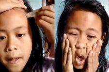 Ekspresi bocah pakai minyak angin sebagai foundation, bikin geregetan