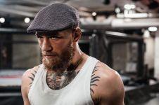 Arogan & garang di ring UFC, begini 10 momen McGregor saat momong anak