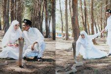 Pasangan pengantin ini pemotretan bareng king kobra, ngeri-ngeri sedap