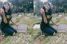 Wanita ini ke makam ayahnya pakai kaus & celana sobek, alasannya haru