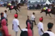 Masuk ke lintasan pacuan kuda, fotografer ini berakhir tragis