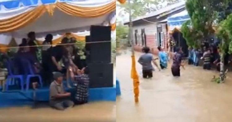 Momen warga joget dangdut di tengah genangan banjir, tetap asyik