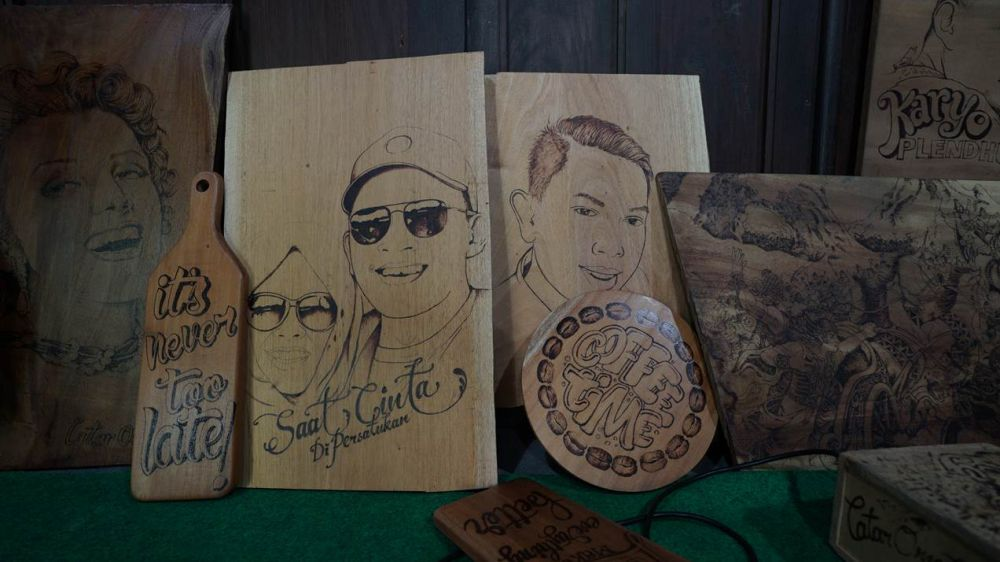 lukisan wajah dari api brilio.net
