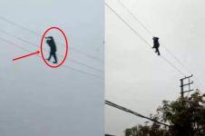 Kelakuan pria mabuk ini konyol, jalan di kabel listrik tegangan tinggi
