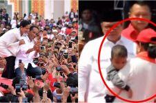 Momen Iriana Jokowi tolong anak kepanasan di arena kampanye