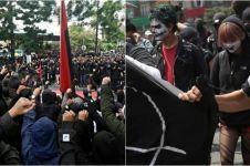 Fakta Anarko Sindikalisme, massa berbaju hitam di Hari Buruh