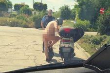 Pria ini ditilang polisi karena bertingkah aneh saat kepanasan