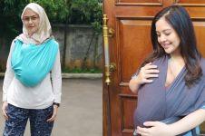 Gaya 7 seleb gendong bayi ini tuai kritik, terbaru Tasya Kamila