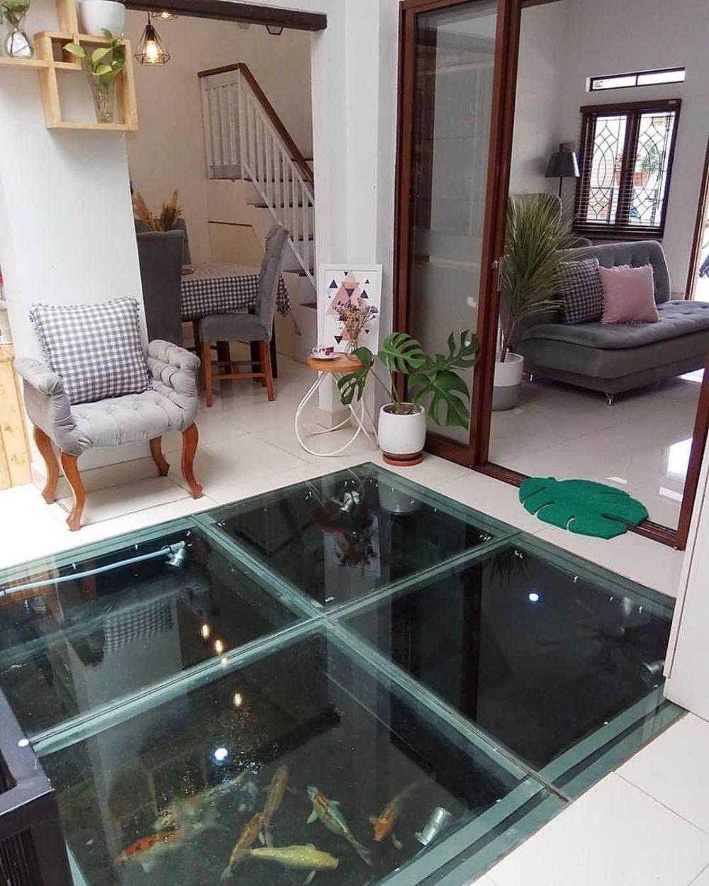 1067399 1000xauto desain kolam ikan dalam ruangan
