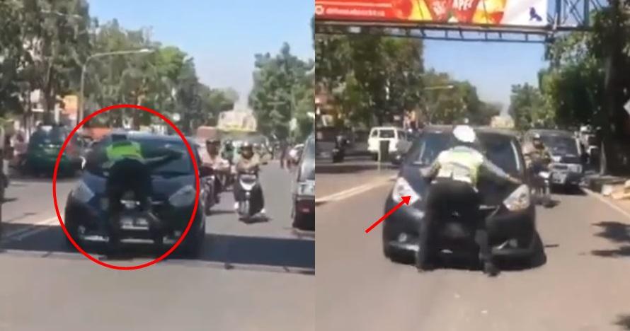 Aksi heroik polisi berhentikan pengemudi sampai naik ke kap mobil