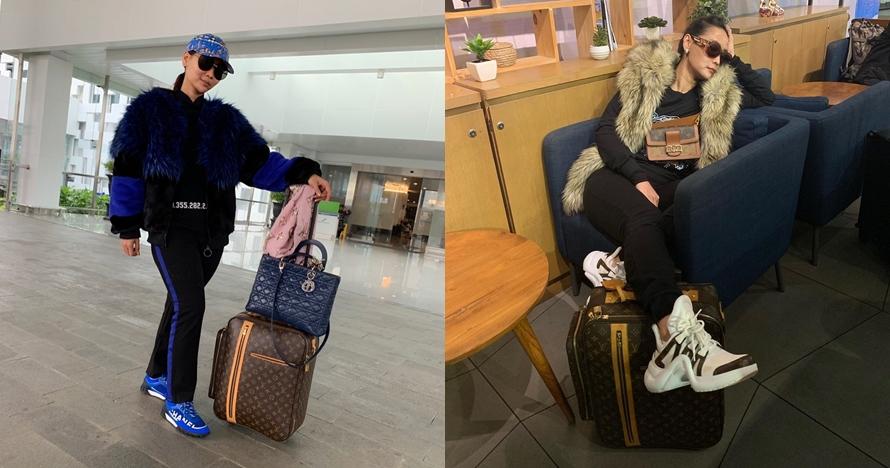 12 Gaya airport fashion Inul Daratista, penuh barang mewah