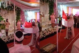 Menikah 17 Agustus, pengantin ini gelar upacara bendera di resepsi