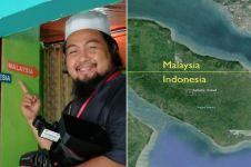 Rumah ini berdiri di tengah garis batas Malaysia & Indonesia, unik