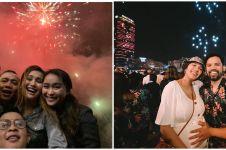 Momen meriah perayaan tahun baru 11 seleb, penuh kebahagiaan