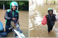 7 Momen driver ojek online layani pelanggan saat banjir, salut