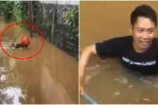 Kisah pria terjang banjir demi antar makanan ke kos teman, salut