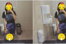 Selfie di cermin toilet mal, cewek ini potret penampakan serem